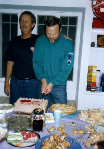 P338.086m.r.t Charles McKain and Bob McWilliams cutting a Happy 20th Anniversary cake