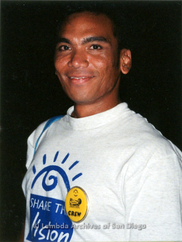 """P119.072m.r.t San Diego Pride 1997: Close-up of a man wearing """"Share the Vision"""" t-shirt and """"crew"""" button"""