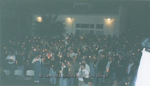 P236.006m.r.t Matthew Shepard Memorial at The Center 1998: Group of people holding candles, Mark Conlan in front