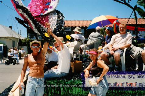 P018.164m.r.t San Diego Pride Parade1999: Men and women waiting with parade float
