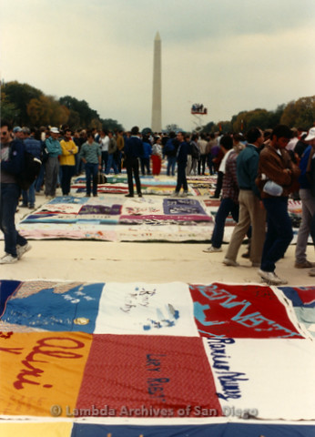 P323.022m.r.t AIDS Quilt at National Mall 1987: Long view of AIDS Quilt in front of the Washington Monument with a crowd in the distance