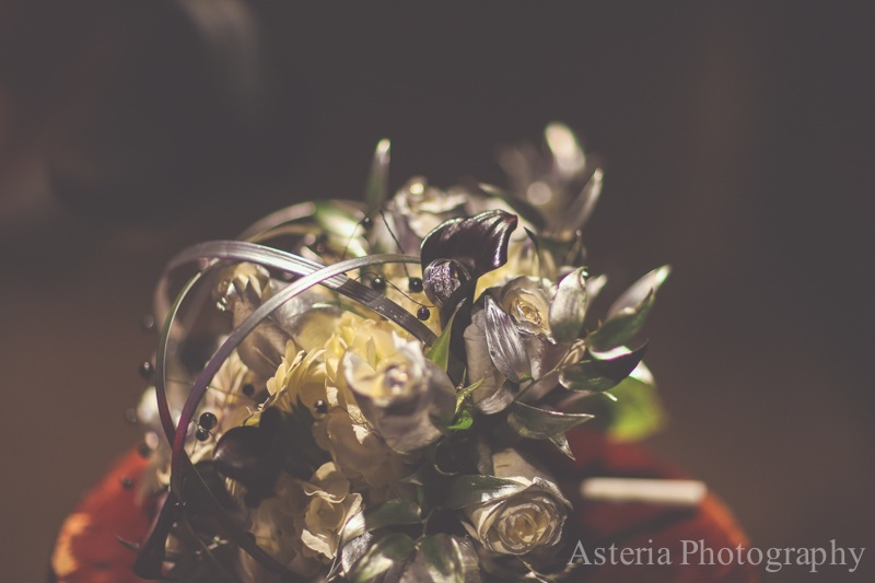 Close-up of Bride's bouquet with wedding rings in it