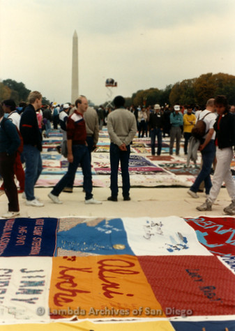 P323.006m.r.t AIDS Quilt at National Mall 1987: People walking by AIDS Quilt with Washington Monument in the background