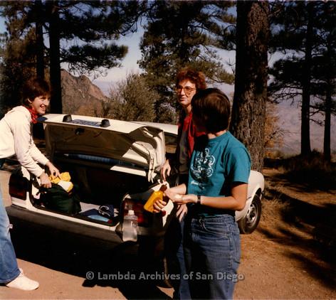 P008.104m.r.t Laguna Mountains November 1984: Toni, Katherine, and Marghi Kilmer unpacking the car