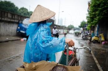 Street Vendor in Rain Coat