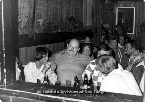 C. 1980 - Ray Finch's Birthday inside Diablo's Lesbian bar on El Cajon Blvd: Ray Finch (center), surrounded by friends celebrating his birthday.