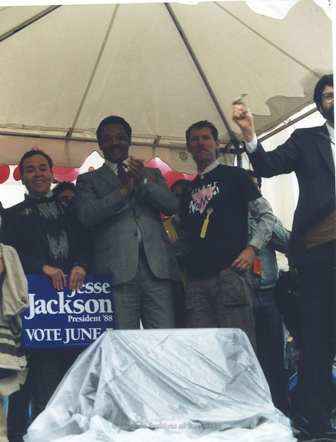 Nicole Murray Ramirez(left) and Albert Bell(right) standing with Jesse Jackson at 2nd March on Washington for Lesbian and Gay Rights, October 11, 1987