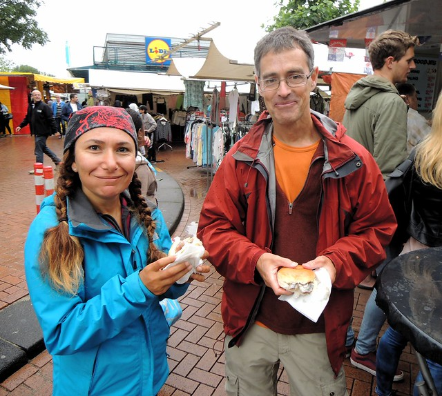 A real Dutch experience -- eating raw herring and onion sandwichs in the rain.  Ferda thought it was awful. by bryandkeith on flickr
