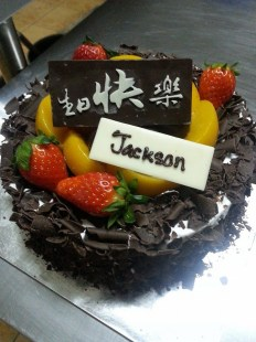 Chocolate fruit cake with chocolate sponge and fresh fruit.