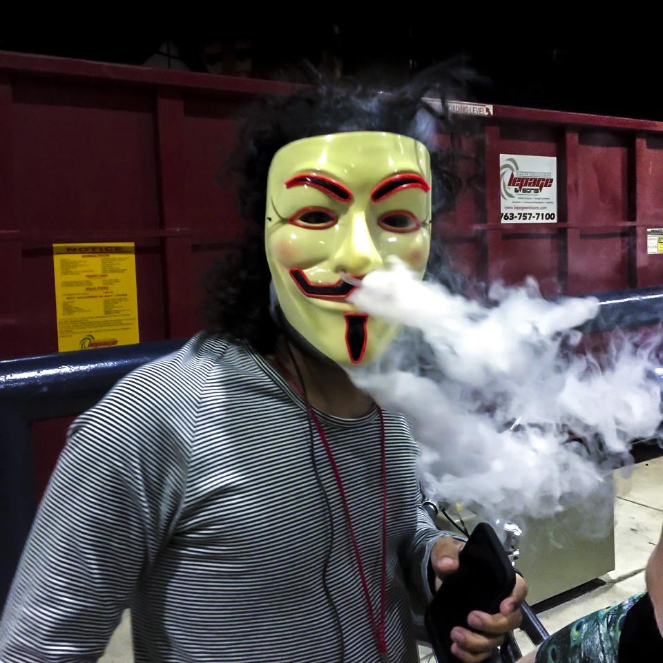anonymous vaper blowing vape