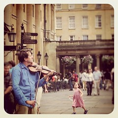More from Limey Land : a little girl dancing to a violinist in the square in Bath