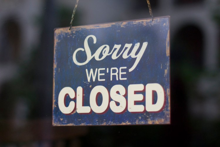 """Restaurant's """"Sorry we're Closed"""" sign 