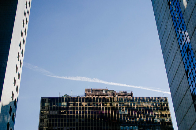 Tall, glassy buildings and whispy clouds