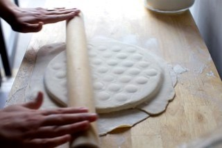 add the top dough and roll to encase the filling