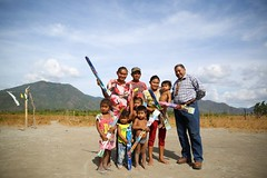 Minister of Indigenous Peoples' Affairs, Hon. Sydney Allicock distributes kites to children.