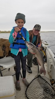 Photo of young girl and catfish she caught