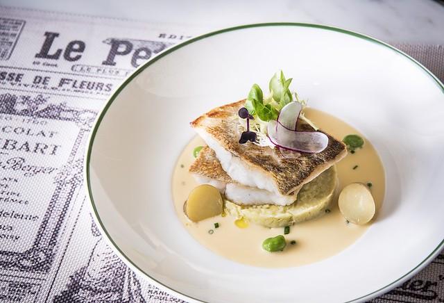 Pan fried zander fish filet on leek fondue in white wine and lemon creamy butter sauce 香煎鱸魚伴大蒜蓉配白酒檸牛油汁