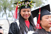 """Smiling 2019 graduate during ceremony. The University of Hawaii–West Oahu held spring commencement on May 4, 2019 at the Lower Courtyard. View more photos on the UH West Oahu Flickr site at: <a href=""""https://www.flickr.com/photos/uhwestoahu/albums/72157678118707327"""">www.flickr.com/photos/uhwestoahu/albums/72157678118707327</a>"""