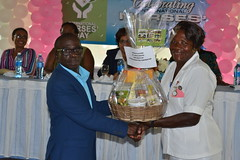A nurse receives a token of appreciation from Chief Executive Officer (CEO) Brigadier (ret'd) George Lewis.