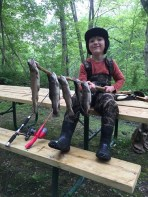 The look on Dexter Webster's face says it all after a day trout fishing with his grandfather.