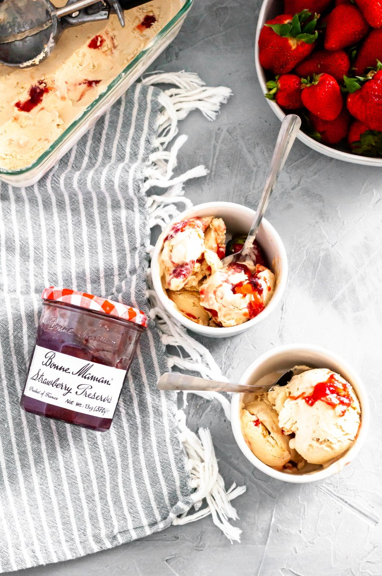 Combine two childhood classics with this Peanut Butter and Jelly Ice Cream. Smooth, creamy peanut butter ice cream, crumbled vanilla cookies and a jelly swirl.