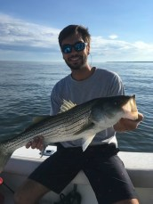 Photo of man with striped bass
