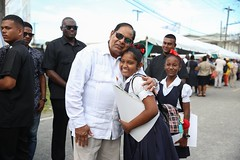 Prime Minister, Hon. Moses Nagamootoo embrace a student of Region 7.