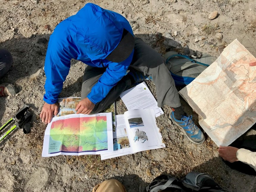 201806_USFS_GiffordPinchot_Hydrologist reviewing data on the pumice plain. Photo by Johna Hogervorst, Forest Service employee