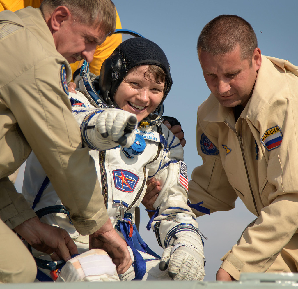 NASA astronaut Anne McClain is helped out of the Soyuz MS-11 spacecraft