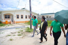 Minister within the Ministry of Communities with responsibility for Housing, Hon. Annette Ferguson walks through the Perseverance Housing Scheme.