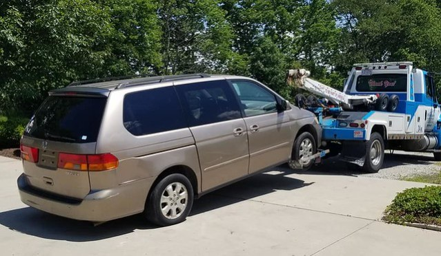Our minivan being towed away