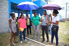 Minister within the Ministry of Communities with responsibility for Housing, Hon. Annette Ferguson interacts with residents.