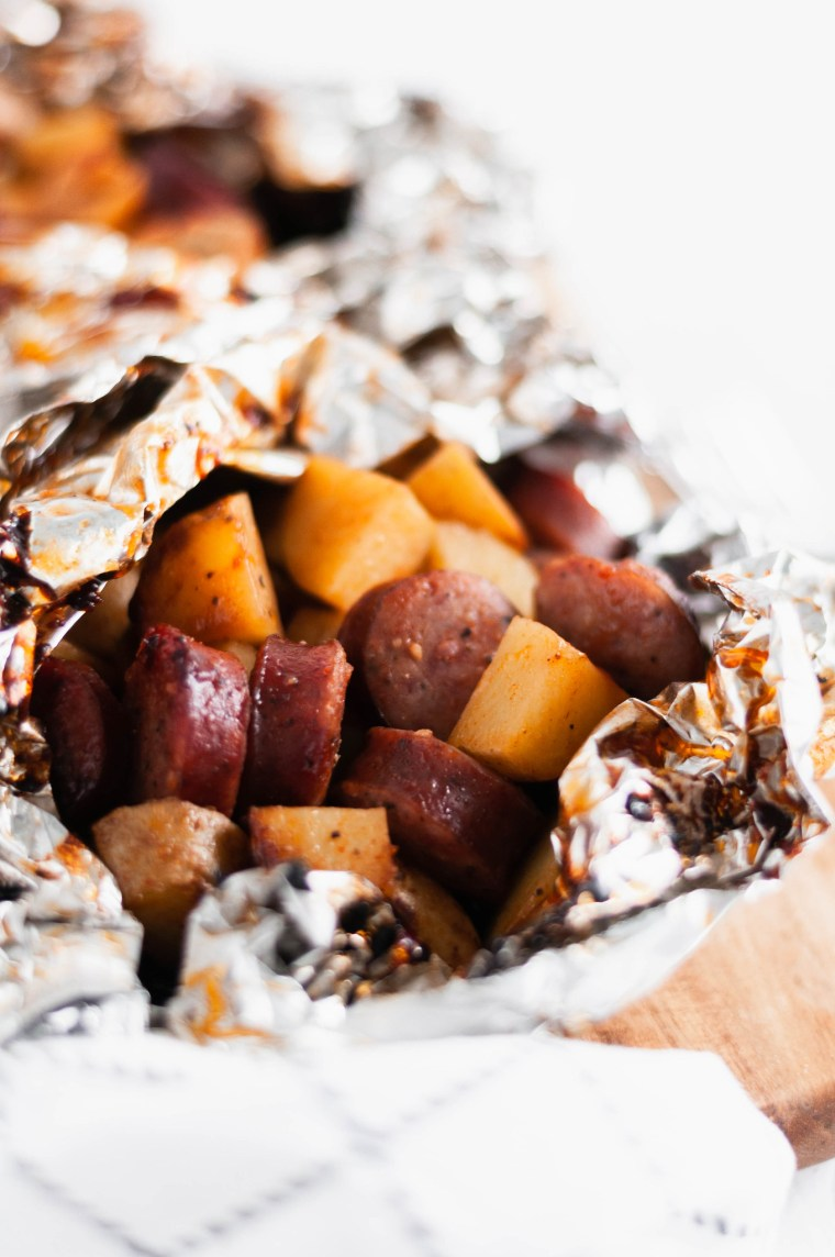 These BBQ Sausage Foil Packs come together in a snap and are done in 30 minutes making them perfect for busy weeknights. Sliced sausage, potatoes and BBQ.