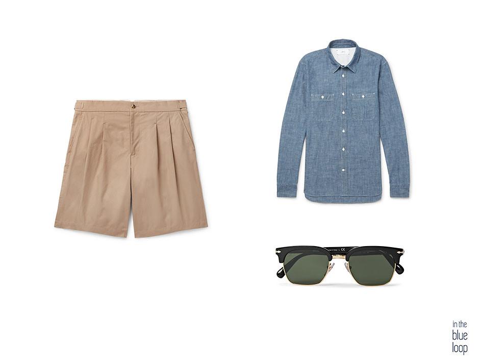 5 maneras de llevar unos pantalones cortos este verano con look smart-casual con pantalón corto de pinzas para hombre con camisa vaquera y gafas de sol