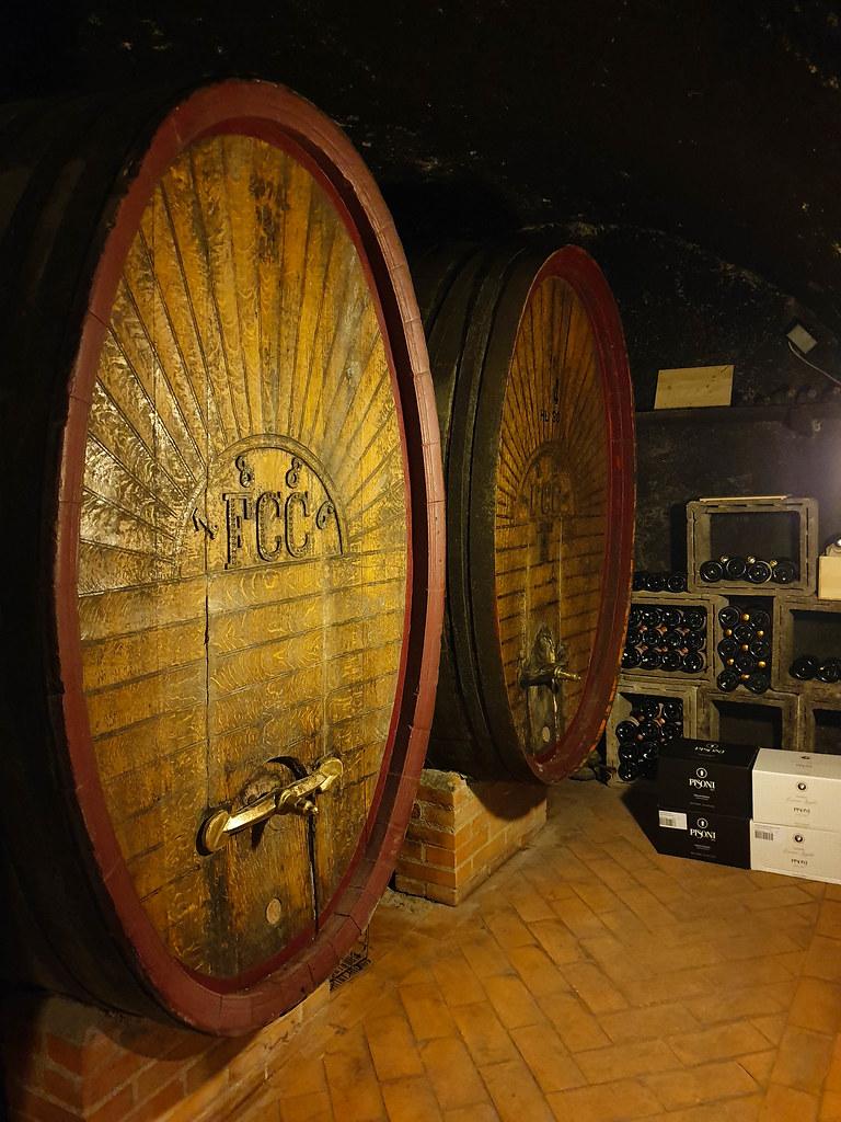 Oak barrels inside a wine cellar