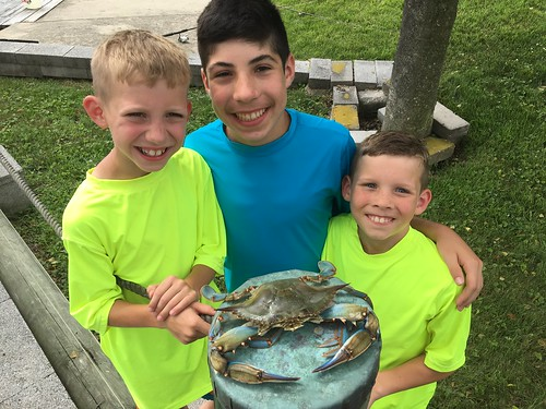 Photo of boys with a jumbo blue crab