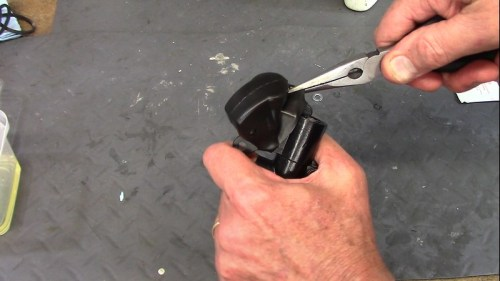 Use Needle Nose Pliers To Install Cover Over Master Cylinder Body