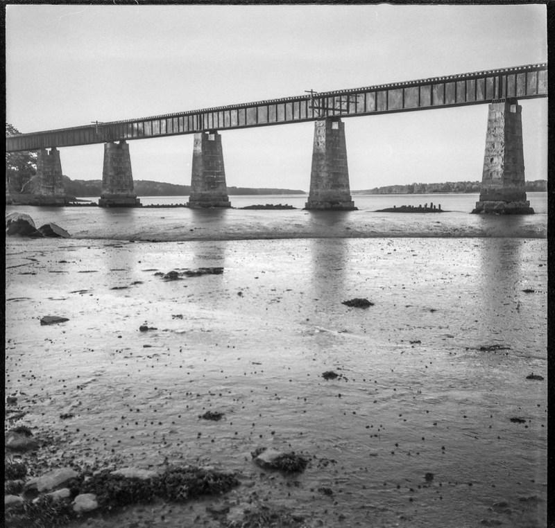 railroad bridge, granite pillars, mudflats, low tide, Thomaston, Maine, Welta Weltur, Arista.Edu 200, HC-110 developer, 7.20.19