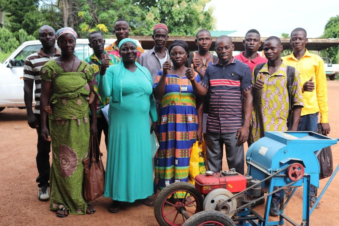 Members of Enye, Nyuri kye Tuna, Tinyogtaa, Zielewye Tidiewulibu, Kandabanye, Sungdiye-Taa, Lanzin and Tie-Taa Maale Farmers Groups pose for a photo with Africa RISING Ghana project staff after a capacity building training on developing group constitution