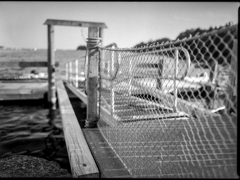dock entrance, wire fence, ramp, harbor, Thomaston, Maine, Mamiya 645 Pro, mamiya sekor 45mm f-2.8, Kodak TMAX 400, HC-110 developer, August 2019
