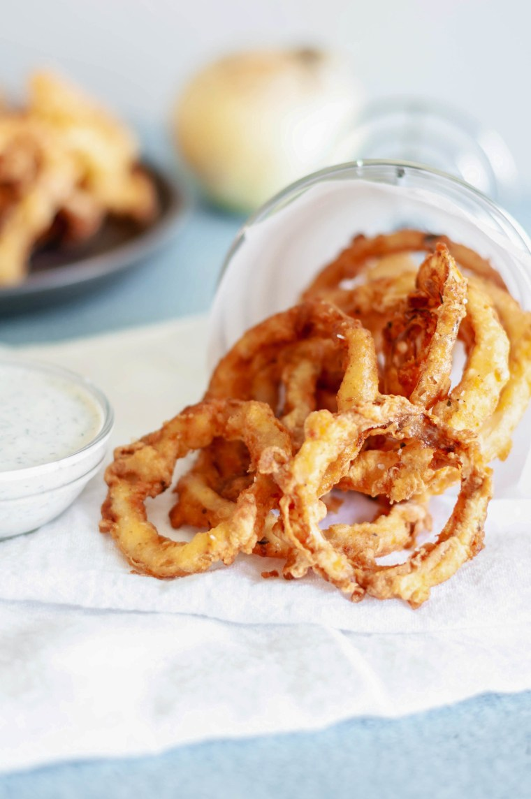 These Crispy Onion Rings with Buttermilk Dill Dressing will be the hit of the party. Perfect for appetizers, game day or to go with your burgers.