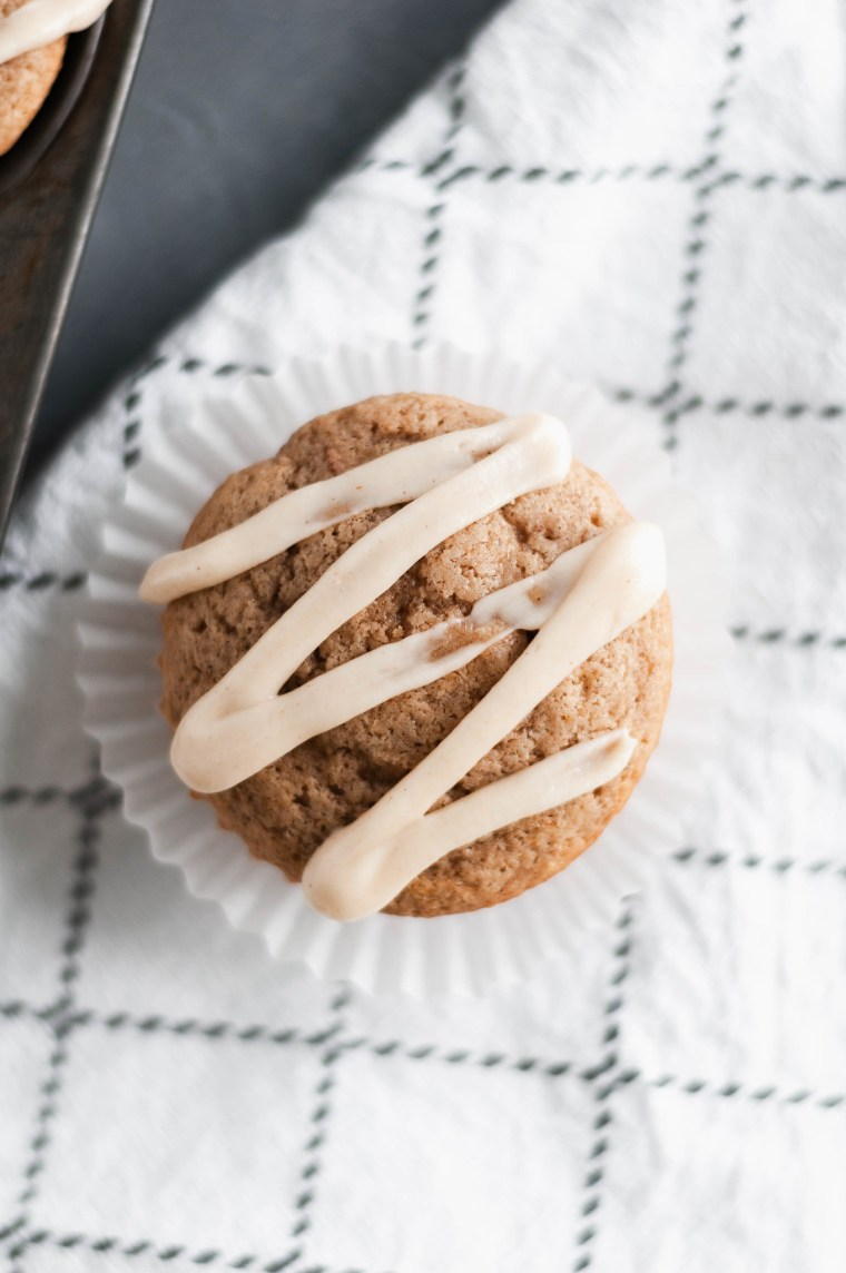 These apple muffins with cream cheese glaze are the perfect fall breakfast. Spice cake mix makes these simple to make and packed full of flavor. Grab your ingredients and get to baking.