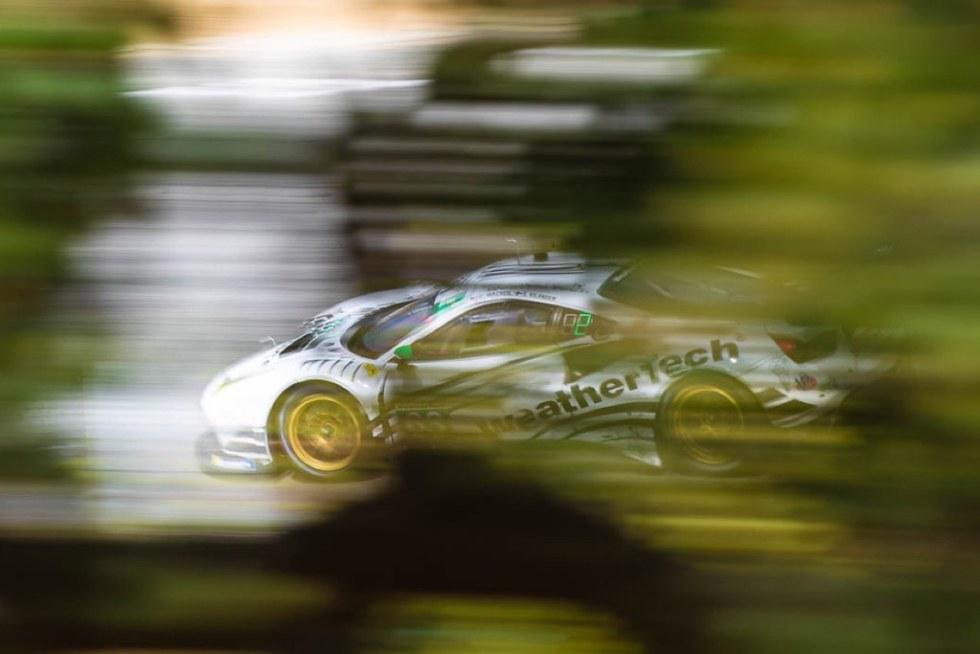 Ferrari 488 through the trees at the Corkscrew