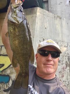 Photo of man holding a smallmouth bass.