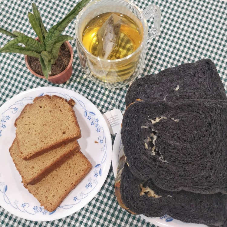 2 pieces of Cheesy Charcoal Almond Loaf (PhP 250), 2 pieces of Banana Saba Sourdough Loaf (PhP 200) and Green Tea with Kombucha