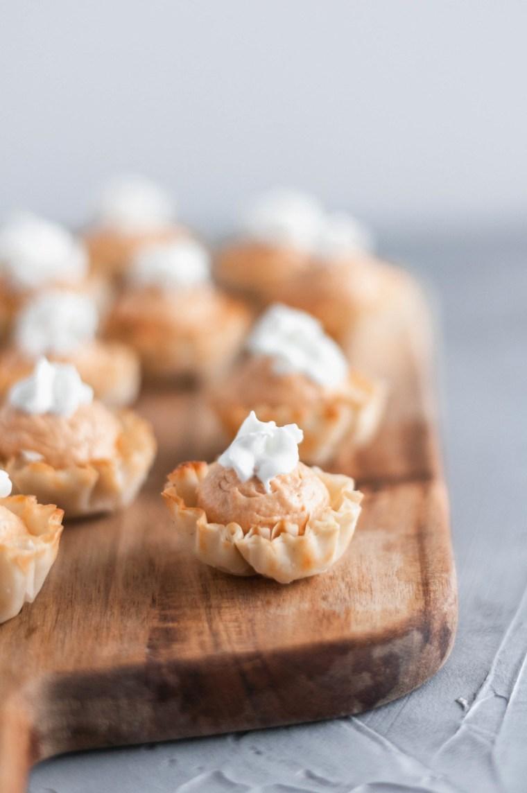 Mini Pumpkin Cheesecake Bites are a super simple dessert recipe everyone will love this fall. No bake pumpkin cheesecake filling and crispy dessert shells.