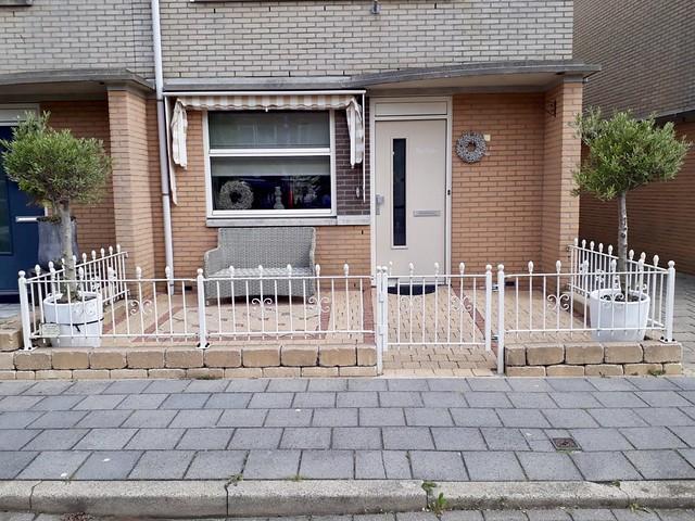 Voorzijde huis hek landelijke stijl