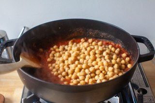 add the tomatoes and chickpeas