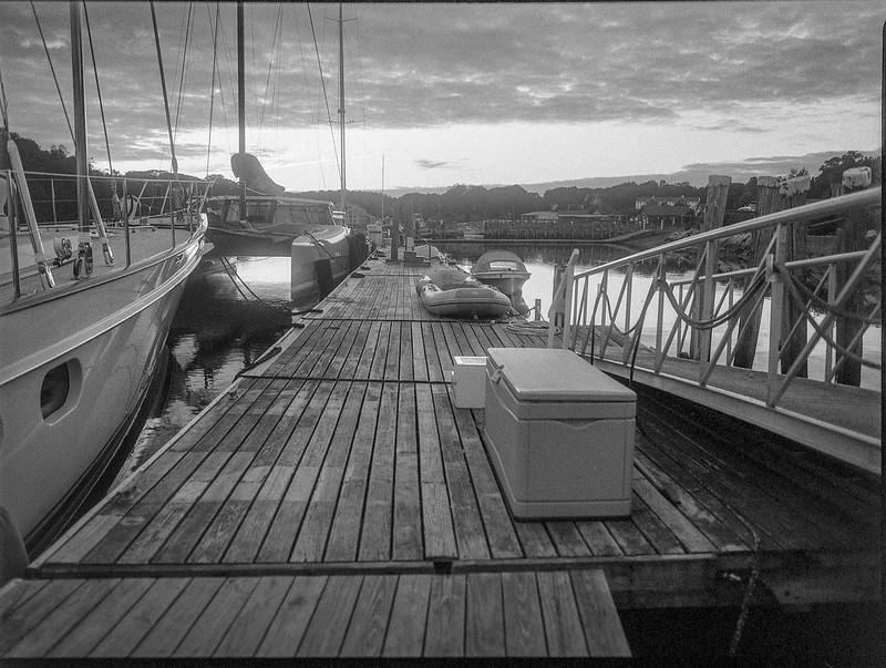 near dusk, dock, ramp, sailing vessels, harbor, Thomaston, Maine, Mamiya 645 Pro, mamiya sekor 45mm f-2.8, Bergger Pancro 400, HC-110 developer, 9.13.19 (1 of 1)