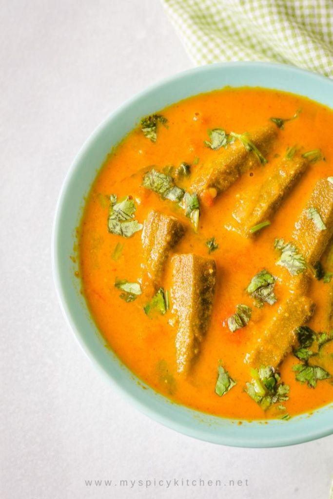 Bowl of tomato bhendi shorva or okra tomato stew, a side dish for rice and Indian flatbreads